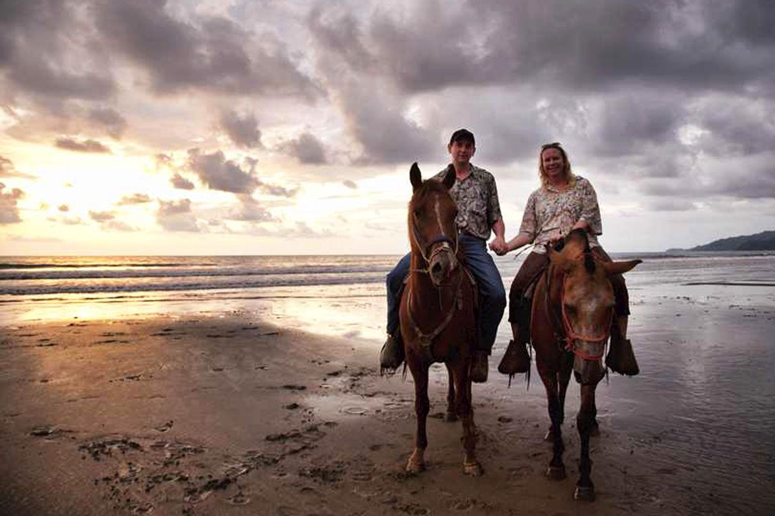 Couple horseback riding during their stay at Rancho Pacifico, the best costa rica adventure resort.