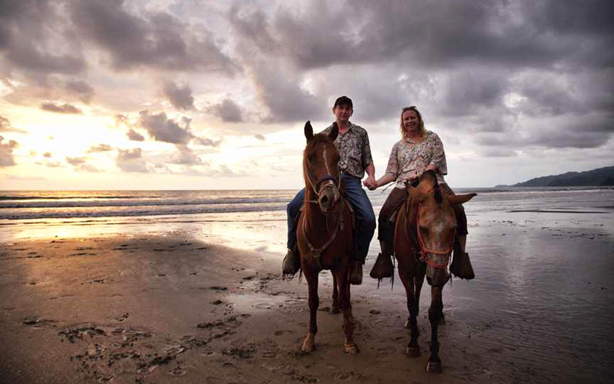 Couple horseback riding during their stay at Rancho Pacifico adventure resort.