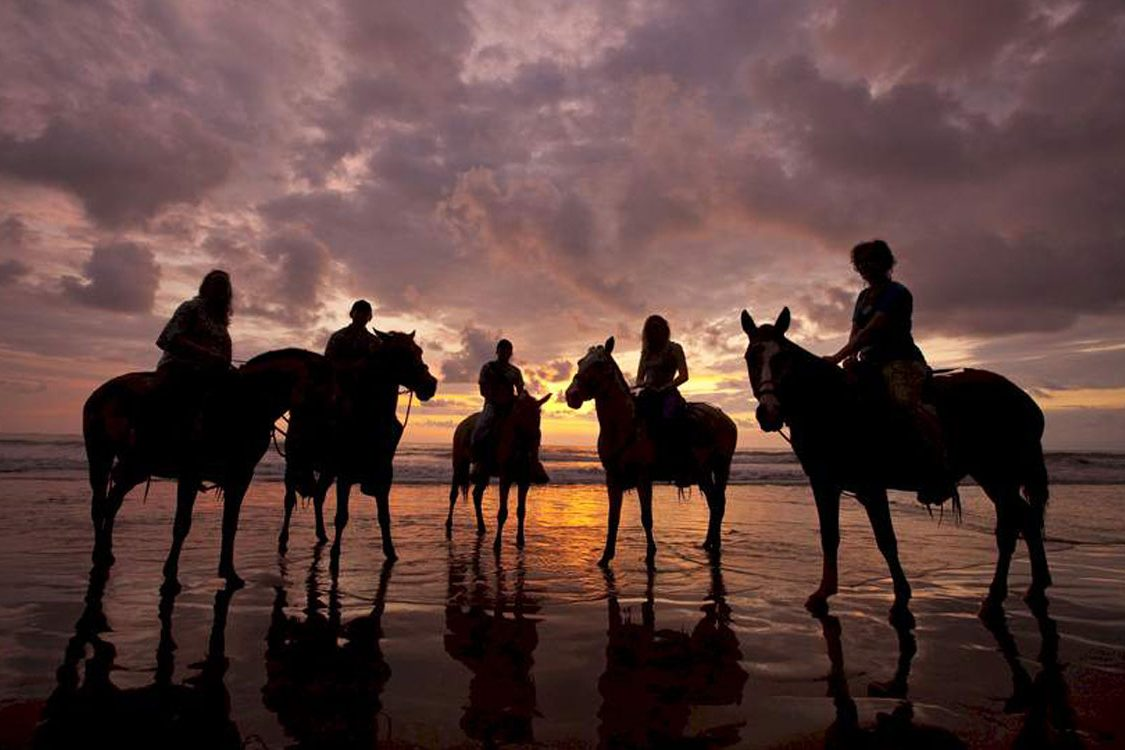 Horseback riding on the beach on your Costa Rica adventure vacation.