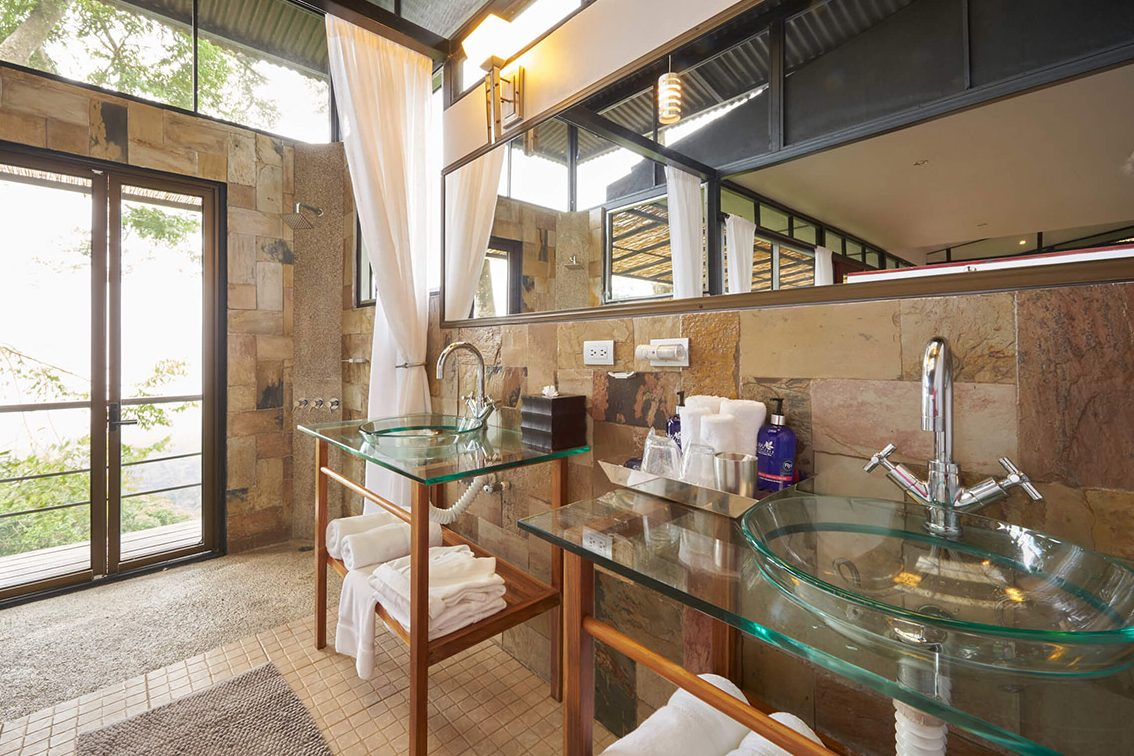 Luxurious bathroom and open-air showers at your treehouse hotel Costa Rica.