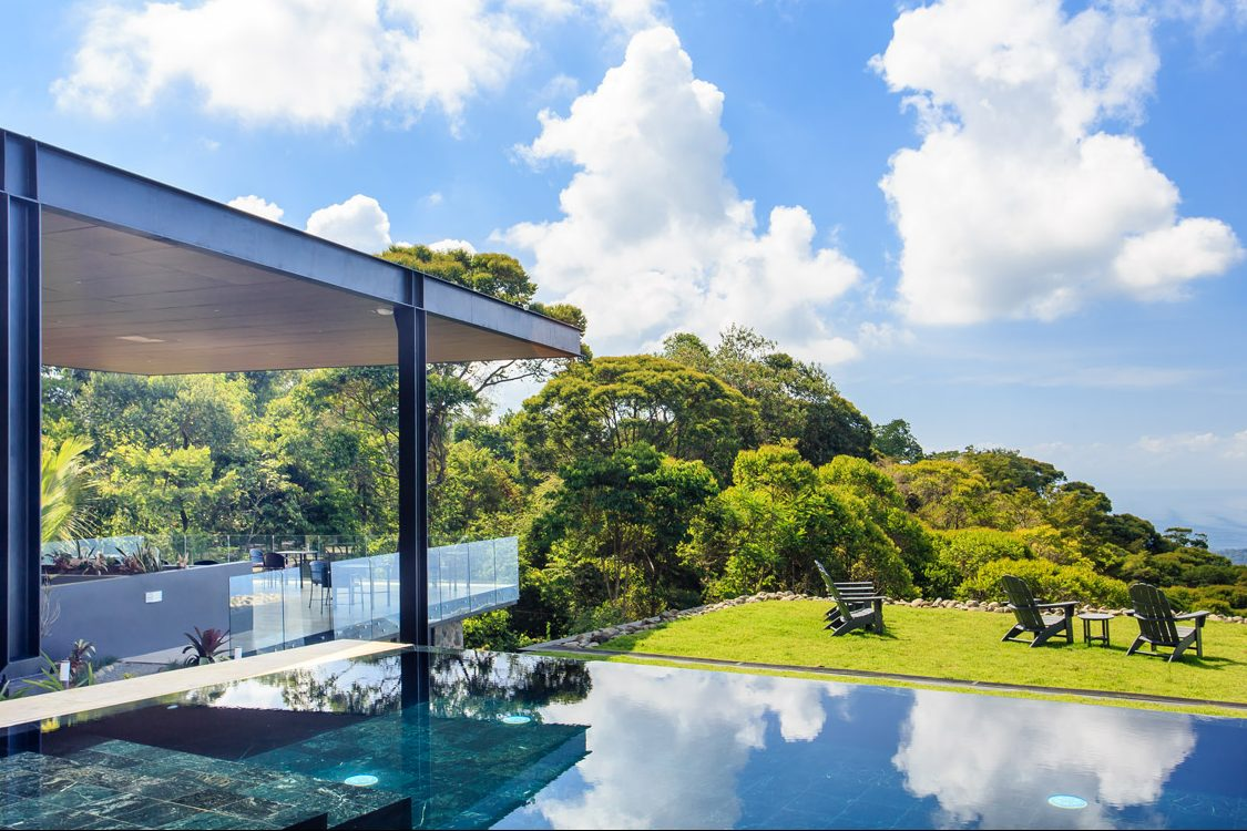 The infinity pool and clubhouse at the Rancho Pacifico Costa Rica luxury resort.