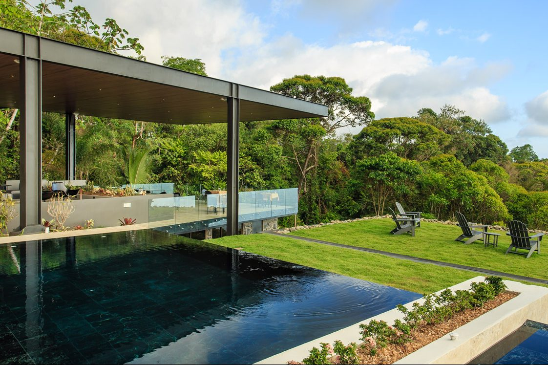 The pool and clubhouse at the Rancho Pacifico Costa Rica luxury resort.